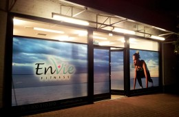 Envie printed window graphic at night
